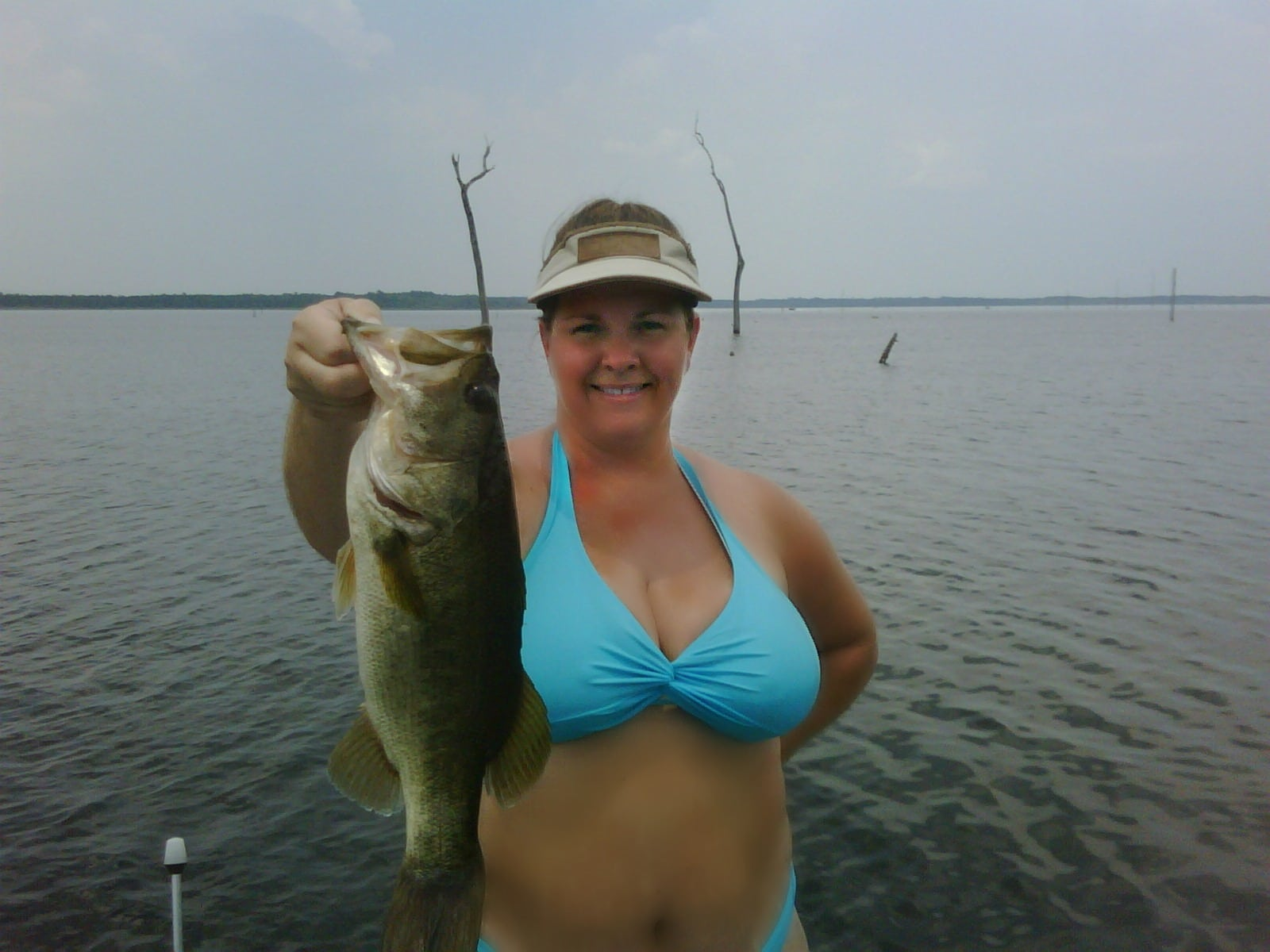 Chubby girl Bass fishing in a bikini