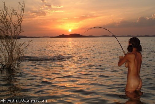 girl fishing nude sunset