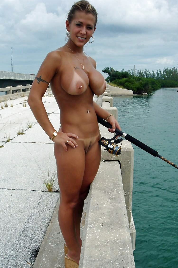 Girl fishing naked from the pier