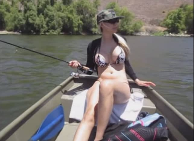Screen Cap of a hot gal in a bikini fishing